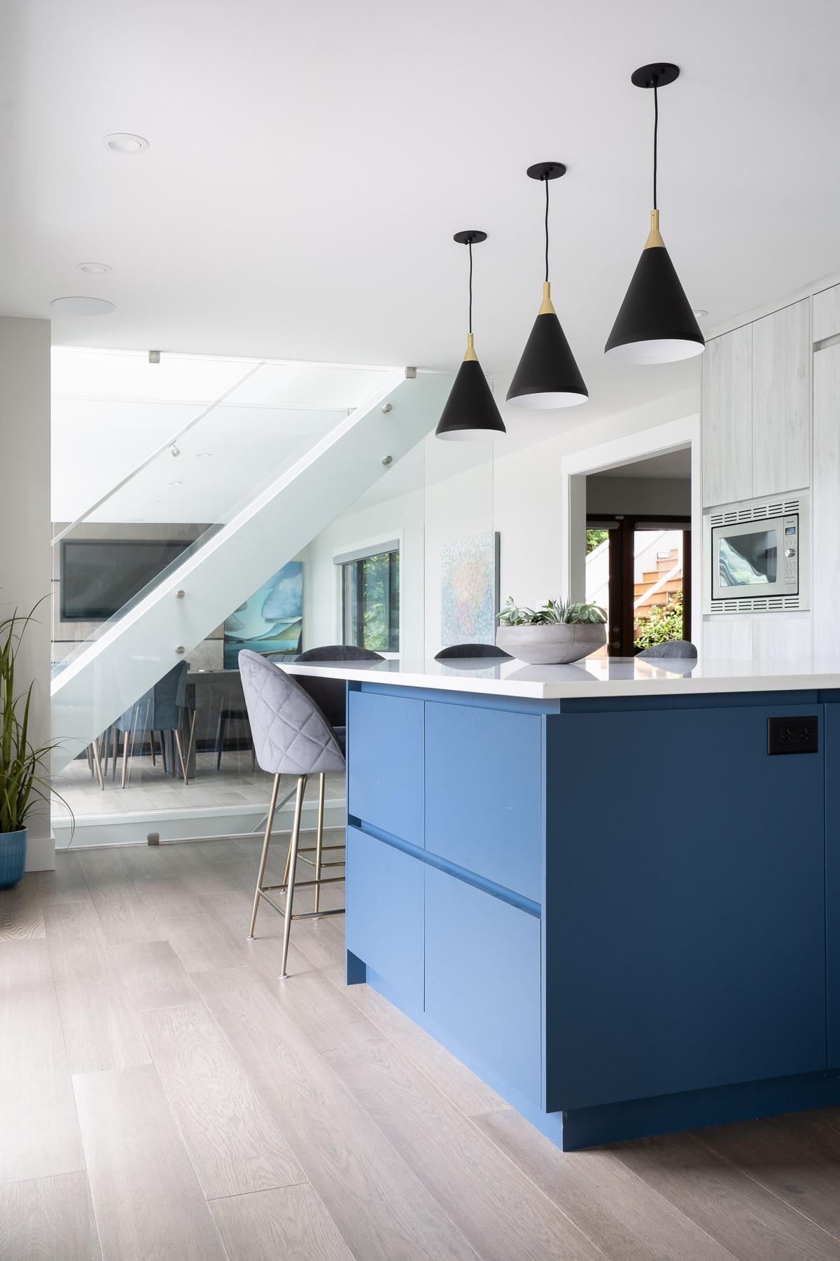Kitchen island blue laminate and white quartz