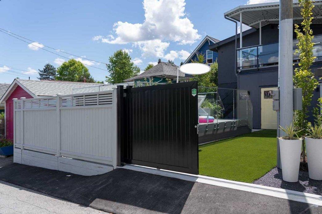 Automatic aluminum gate and cedar fence