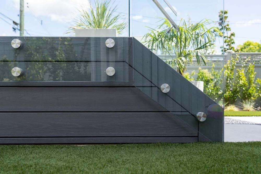Deck with glass railings and stainless steel standoff